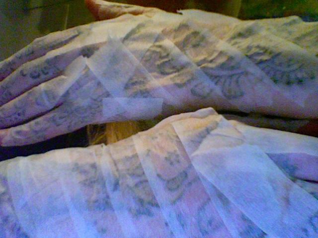 henna bandaged hands