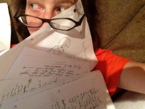 Liz smothered by her own hand written pages
